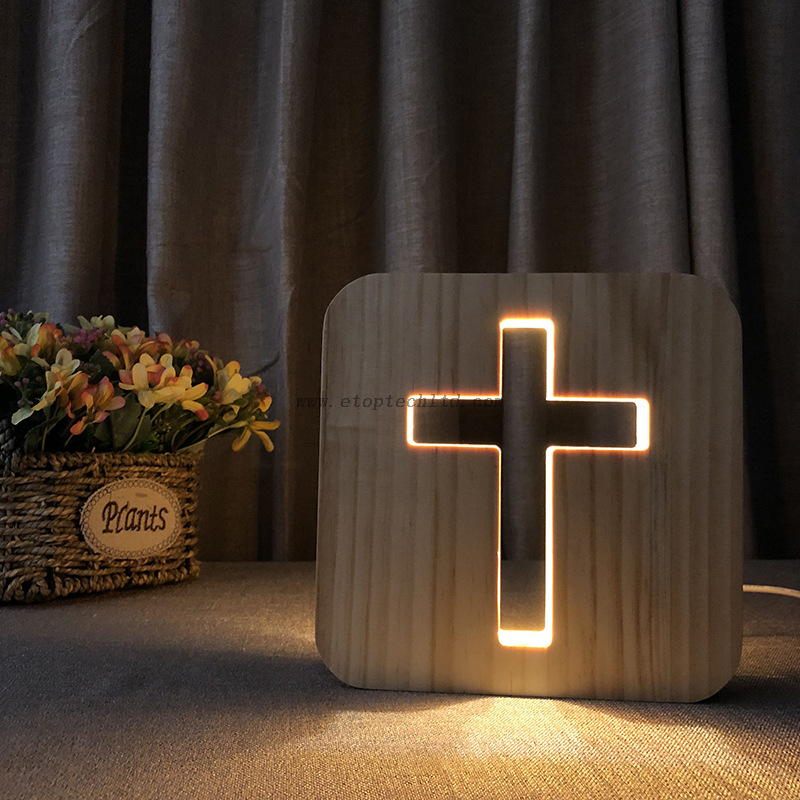 The Cross Light Wood LED Night Table Lamps designed by E-Top (HK) Technology Limited